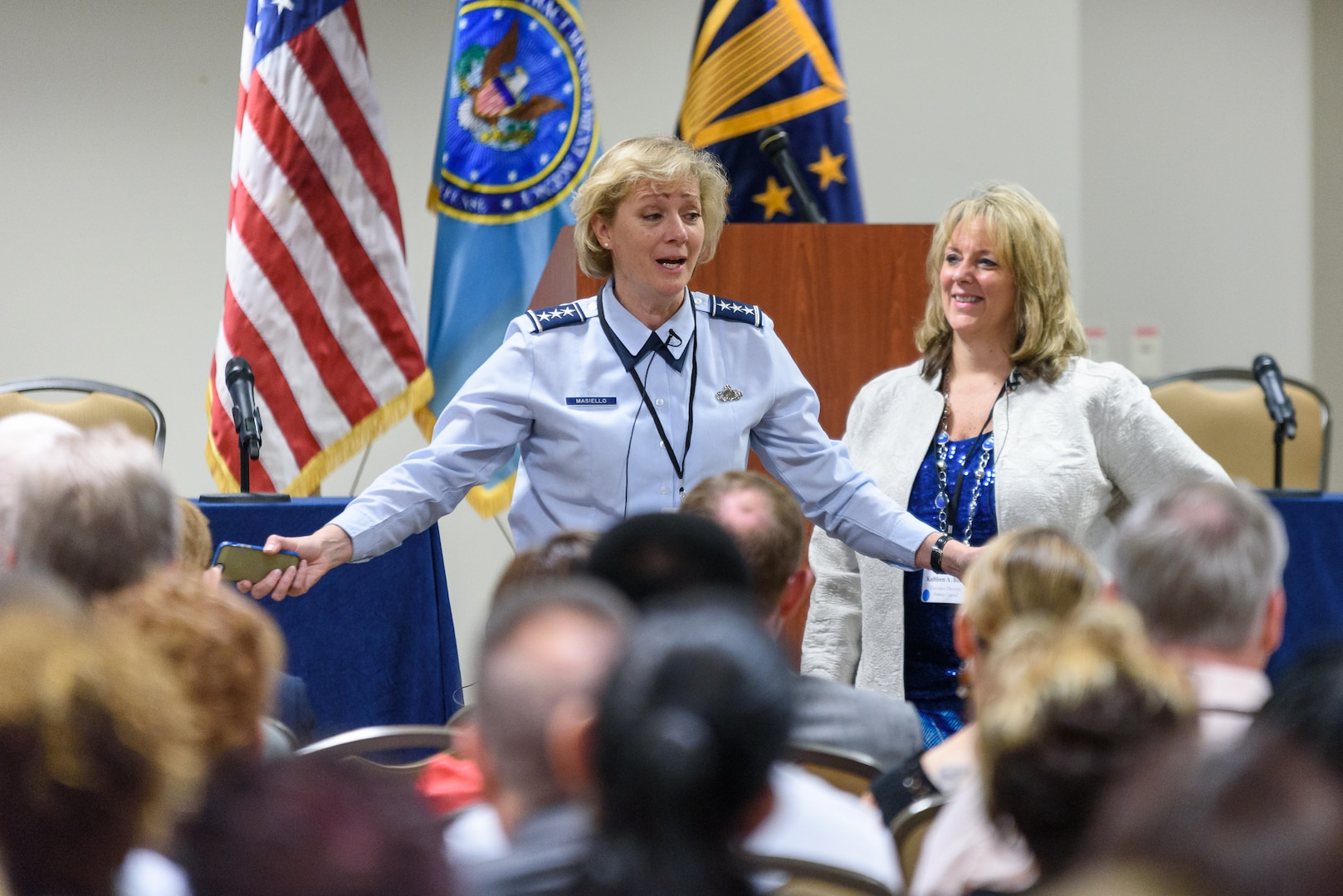 Kathy Butera, Defense Contract Management Agency Human Capital director, looks on as Air Force Lt. Gen. Wendy Masiello, agency director, talks with DCMA professionals during a recent three-day training workshop. (DCMA photo by Patrick Tremblay)