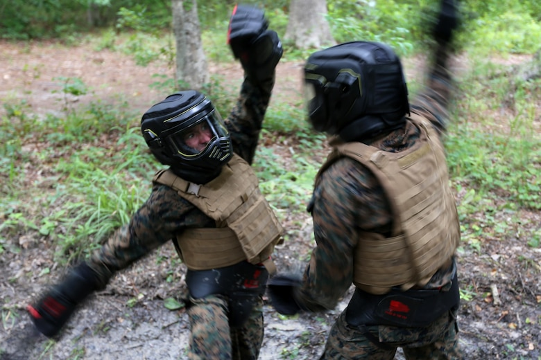 Marines with Marine Wing Communication Squadron 28 participate in a sparring during the four-and-a-half mile endurance course of a Marine Corps Martial Arts Instructor Course at Marine Corps Air Station Cherry Point, N.C., July 1, 2016. The endurance course was the culminating event of three weeks of physical, mental, and character challenges Marines assigned to MWCS-28 completed to earn their instructor tabs. MCMAP is a combat system that trains Marines in the art of hand-to-hand and close quarters combat techniques while building morale and team-building functions. This MCMAP instructor course was conducted by the unit to certify Marines with the responsibility of instructing and training Marines in MCMAP. MWCS-28 is one of the squadrons assigned to Marine Air Control Group 28, 2nd Marine Aircraft Wing. (U.S. Marine Corps photo by Cpl. N.W. Huertas/Released)