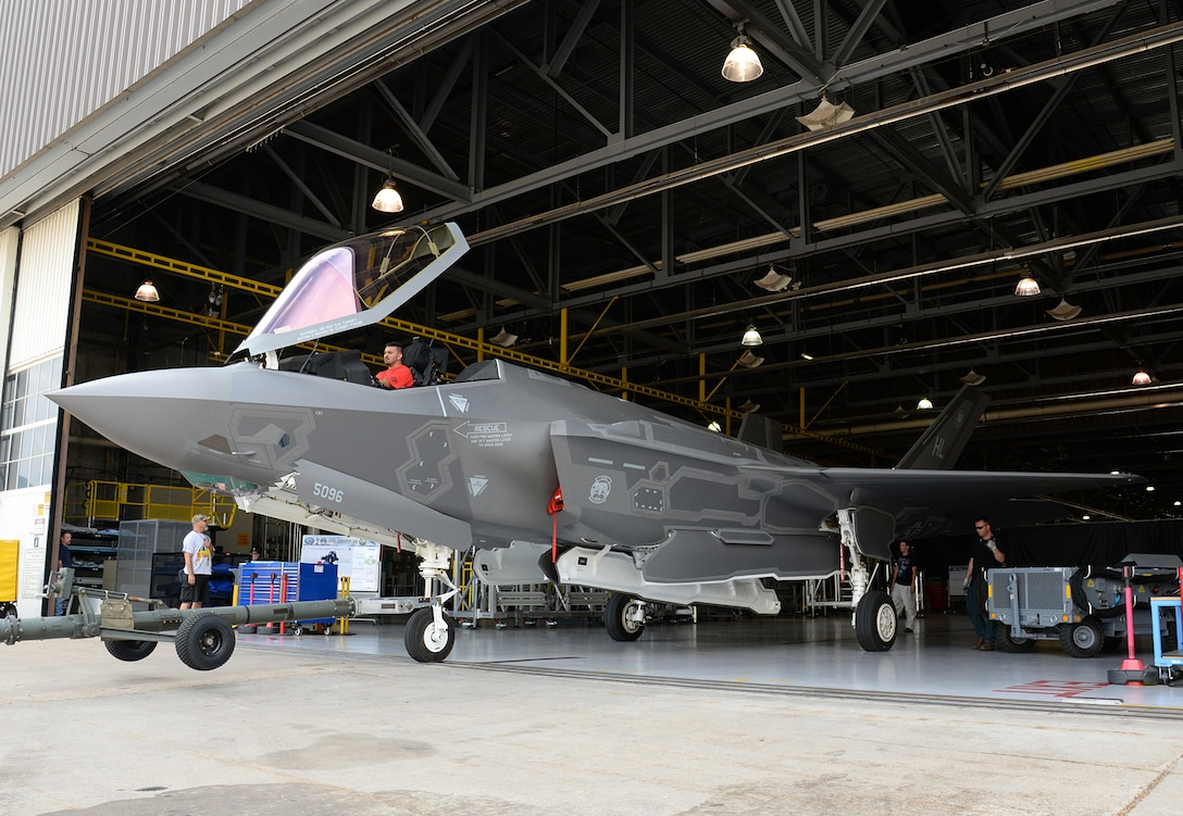 The twelfth F-35A Lightning II aircraft needed to declare initial operational capability (IOC) emerges from a repair hangar after depot and unit-level modifications were completed June 30, 2016 at Hill Air Force Base, Utah. The modifications were needed to correct an overpressure condition in the fuel system during elevated G-maneuvers and fuel migration between internal fuel tanks. (U.S. Air Force Photo by Alex R. Lloyd)