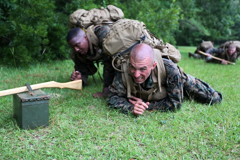Marines with Marine Wing Communication Squadron 28 participate in a team event during the four-and-a-half mile endurance course of a Marine Corps Martial Arts Instructor Course at Marine Corps Air Station Cherry Point, N.C., July 1, 2016. The endurance course was the culminating event of three weeks of physical, mental, and character challenges Marines assigned to MWCS-28 completed to earn their instructor tabs. MCMAP is a combat system that trains Marines in the art of hand-to-hand and close quarters combat techniques while building morale and team-building functions. This MCMAP instructor course was conducted by the unit to certify Marines with the responsibility of instructing and training Marines in MCMAP. (U.S. Marine Corps photo by Cpl. N.W. Huertas/Released)