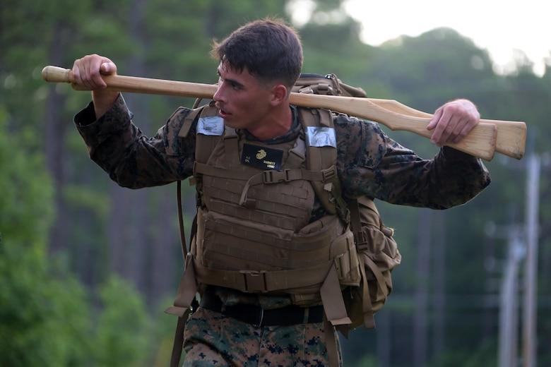 Cpl. Anthony Barnett hikes a trail during the four-and-a-half mile endurance course of a Marine Corps Martial Arts Instructor Course at Marine Corps Air Station Cherry Point, N.C., July 1, 2016. The endurance course was the culminating event of three weeks of physical, mental, and character challenges Marines assigned to Marine Wing Communications Squadron 28 completed to earn their instructor tabs. MCMAP is a combat system that trains Marines in the art of hand-to-hand and close quarters combat techniques while building morale and teamwork. This MCMAP instructor course was conducted by the unit to certify Marines with the responsibility of instructing and training Marines in MCMAP.  Barnett is a ground radar repairer assigned to MWCS-28, Marine Air Control Group 28, 2nd Marine Aircraft Wing. (U.S. Marine Corps photo by Cpl. N.W. Huertas/Released)