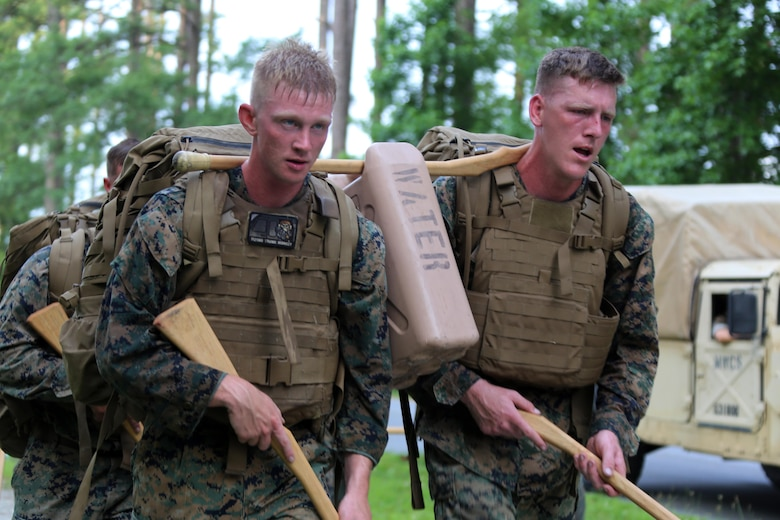Marines with Marine Wing Communication Squadron 28 hike a trail during the four-and-a-half mile endurance course of a Marine Corps Martial Arts Instructor Course at Marine Corps Air Station Cherry Point, N.C., July 1, 2016. The endurance course was the culminating event of three weeks of physical, mental, and character challenges Marines assigned to MWCS-28 completed to earn their instructor tabs. MCMAP is a combat system that trains Marines in the art of hand-to-hand and close quarters combat techniques while building morale and teamwork. This MCMAP instructor course was conducted by the unit to certify Marines with the responsibility of instructing and training Marines in MCMAP. MWCS-28 is one of the squadrons assigned to Marine Air Control Group 28, 2nd Marine Aircraft Wing. (U.S. Marine Corps photo by Cpl. N.W. Huertas/Released)
