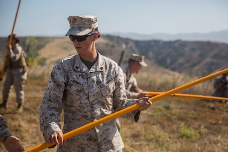 MARINE CORPS BASE CAMP PENDLETON, Calif. -- Corporal Tayler Kunkle, an accident investigator with Law Enforcement Platoon, Koa Moana 16-4, extends a holly stick before locating mock improvised explosive device wires on Camp Pendleton June 23, 2016. A holly stick is used to help confirm the spotting of an IED. Koa Moana seeks to enhance senior military leader engagements between allied and partner nations with a collective interest in military-to-military relations, as well as discuss key aspects of military operations, capability development, and interoperability. (U.S. Marine Corps photo by Sgt. Tony Simmons)
