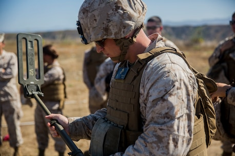 MARINE CORPS BASE CAMP PENDLETON, Calif. -- Corporal David Nygaard, an armorer with Headquarters Platoon, Koa Moana 16-4, calibrates a compact metal detector before locating mock improvised explosive devices on Camp Pendleton June 23, 2016. The CMD is capable of detecting metal or carbon devices during patrols. Koa Moana seeks to enhance senior military leader engagements between allied and partner nations with a collective interest in military-to-military relations, as well as discuss key aspects of military operations, capability development, and interoperability. (U.S. Marine Corps photo by Sgt. Tony Simmons)