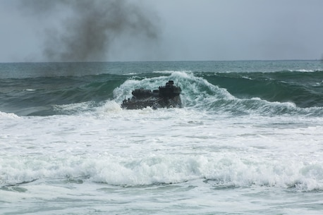An amphibious assault vehicle with Headquarters and Service Company, 3D Assault Amphibian Battalion, 1st Marine Division, conducts amphibious combat sustainment training near White Beach aboard Marine Corps Base Camp Pendleton, Calif., June 38-30, 2016. The battalion is charged with forcible entry and ship-to-shore transportation of the ground combat element of I Marine Expeditionary Force. (U.S. Marine Corps photo by Sgt. Jacob D. Osborne/Released)