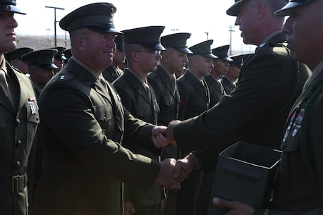 MARINE CORPS BASE CAMP PENDLETON, Calif. - Lt. Col. Hunter Rawlings, commanding officer for 3rd Battalion, 5th Marine Regiment gives Lt. Bradley Spear, the 3rd Battalion, 5th Marine Regiment, 1st Marine Division Chaplain, his French fourragere during a ceremony at Camp Pendleton June 30, 2016. 5th Marines is one of two regiments authorized to wear the French fourragere for actions during World War I. The ceremony emphasized the Marines' commitment to upholding the rich history of the Fighting Fifth. (U.S. Marine Corps photo by Pfc. Joseph Sorci/RELEASED)