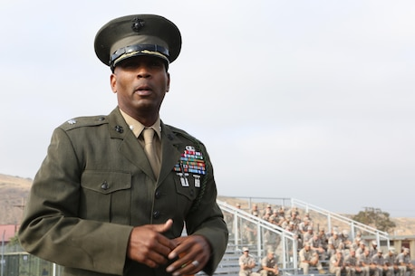MARINE CORPS BASE CAMP PENDLETON, Calif. – Lt. Col. Rafael Candelario, executive officer of the 5th Marine Regiment, speaks to Marines of 5th Marine Regiment during a ceremony at Camp Pendleton, June 30, 2016. Candelario explained the significance of the fourragere and what it means to be a part of 5th Marine Regiment. The ceremony emphasized the Marines' commitment to upholding the rich history of the Fighting Fifth. (U.S. Marine Corps photo by Pfc. Joseph Sorci/RELEASED)