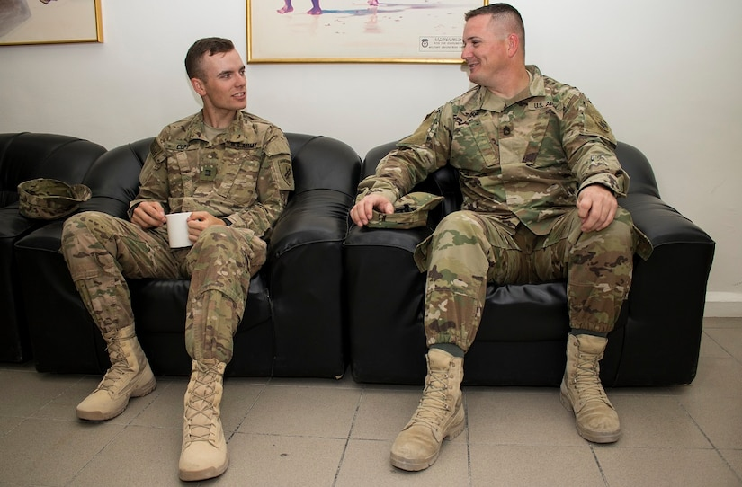 Cadet Spenser Copp, a native of Fairfax, Va. with F Company, 2nd Regiment at the U.S. Military Academy, West Point, N.Y. talks with Sgt. 1st Class Carl Addie, a Cabot, Arkansas native and the Civil Affairs Liaison Officer for Host Nation Affairs, ASG – Ku at the Kuwait Ministry of Defense, June 22. The cadet interned at Camp Arifjan, Kuwait from June 13 to July 1 as part of a unique, hands-on training opportunity hosted by U.S. Army Central's Civil Military Operations and HNA, ASG – Kuwait.