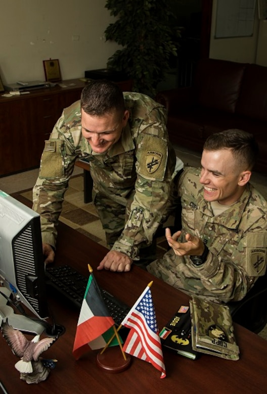 Cadet Spenser Copp, a native of Fairfax, Va. with F Company, 2nd Regiment at the U.S. Military Academy, West Point, N.Y. works with Sgt. 1st Class Carl Addie, a Cabot, Arkansas native and the Civil Affairs Liaison Officer for Host Nation Affairs, ASG – Ku at the HNA, ASG – Ku, June 24. The cadet interned at Camp Arifjan, Kuwait from June 13 to July 1 as part of a unique, hands-on training opportunity hosted by U.S. Army Central's Civil Military Operations and HNA, ASG – Ku.
