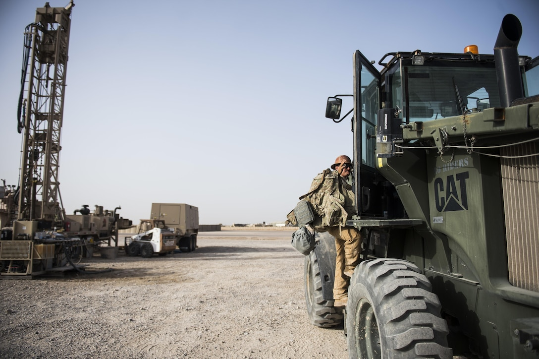 Staff Sgt. David Smith, a well drilling technician assigned to the 557th Expeditionary Red Horse Squadron, climbs into a forklift at Al Taqaddum Air Base, Iraq, June 3, 2016. The 557th ERHS well drilling team are obtaining an organic water source for Al Taqaddum. Red Horse is helping to improve Iraq's infrastructure in support of the Government of Iraq.