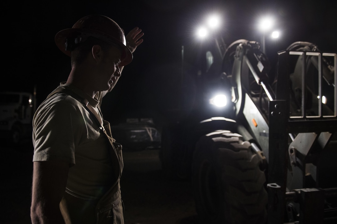 Tech. Sgt. Randy Blount, a well drilling technician assigned to the 557th Expeditionary Red Horse Squadron, guides a forklift to transport a pallet of cement at Al Taqaddum Air Base, Iraq, June 3, 2016. The 557th ERHS well drilling team are obtaining an organic water source for Al Taqaddum. They are the first Air Force entity to drill wells in Iraq.