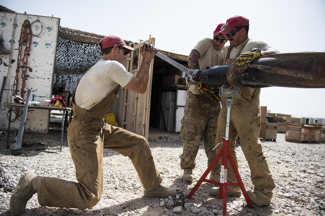 Tech. Sgt. Randy Blount (left), a well drilling technician assigned to the 557th Expeditionary Red Horse Squadron, loosens  a rod on a piece of well drilling equipment at Al Taqaddum Air Base, Iraq, June 5, 2016. The 557th ERHS well drilling team are obtaining an organic water source for Al Taqaddum. Red Horse is helping to improve Iraq's infrastructure in support of the Government of Iraq. (U.S. Air Force photo/Staff Sgt. Larry E. Reid Jr., Released)