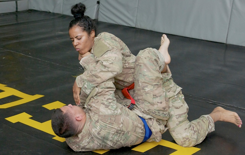 Spc. Dayanna Sanchez, a radiology specialist with the 53rd Head and Neck Surgical Team assigned at Camp Arifjan, Kuwait, and native of Havana, Cuba, competes in the combatives portion of the 2016 USARCENT Soldier of the Year Competition. Sanchez' hard work and dedication recently afforded her the opportunity to be the only female Soldier to participate in the competition.