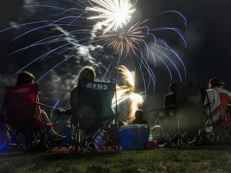 Members of the Morongo Basin community enjoy a fireworks display during the Yucca Valley Independence Day Celebration at Brehm Youth Sports Park, Yucca Valley, Calif., June 4, 2016. (Official Marine Corps photo by Lance Cpl. Levi Schultz/Released)