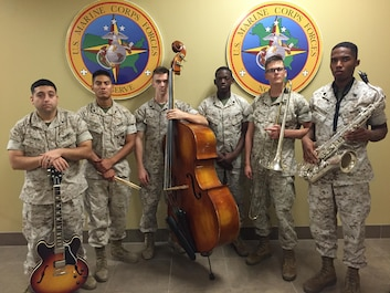 Marine Corps Band New Orleans Jazz Ensemble Marines pose for a picture after receiving Marine Corps Band Small Ensemble of the Year for fiscal year 2015 in New Orleans, July 7, 2016.  The members of the Jazz Ensemble won by selecting a unique piece called Martha's Prize by Cedar Walton performed by singer and drummer Jamison Ross, a local New Orleans musician.  (U.S. Marine Corps photo by Lance Cpl. Devan A. Barnett)