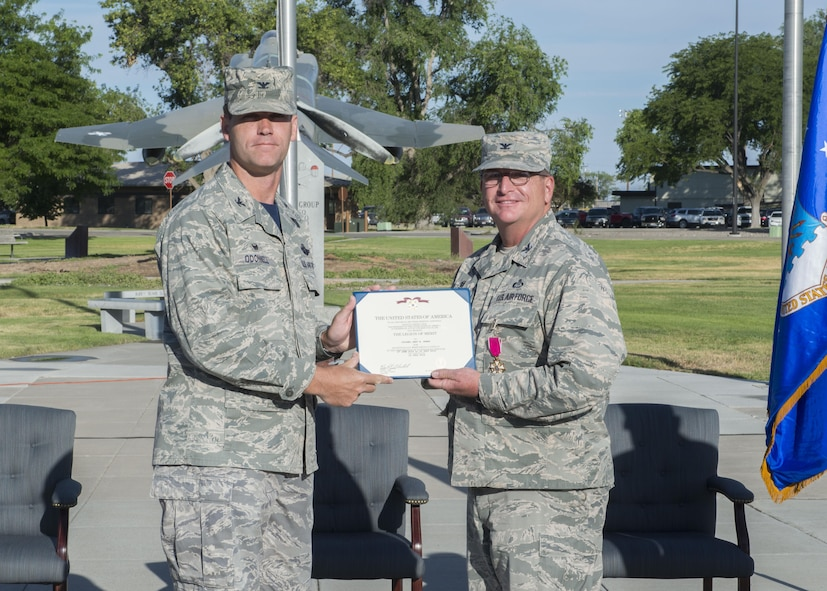 Col. Jefferson O'Donnell (left), 366th Fighter Wing commander, presents Col. Gary Kubat, 366th Mission Support Group commander, the Legion of Merit July 8, 2016, at Mountain Home Air Force Base, Idaho. As 366th MSG commander, Kubat commands a group of 2,000 personnel. (U.S. Air Force photo by Senior Airman Malissa Lott/RELEASED)