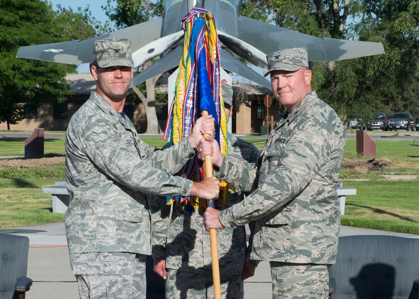 Col. John Blackwell (right) assumes command of the 366th Mission Support Group from Col. Jefferson O'Donnell, 366th Fighter Wing commander, July 8, 2016, at Mountain Home Air Force Base, Idaho. Previously, Blackwell served as Chief, Air Force Portfolio Management Division, Air Force Civil Engineer Center at Joint Base San Antonio-Lakeland, Texas. (U.S. Air Force photo by Senior Airman Malissa Lott/RELEASED