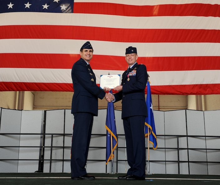 Col. Douglas lee (right) out-going 9th Reconnaissance Wing commander accepts the Legion of Merit medal during a change of command ceremony at Beale Air Force Base, California July 8, 2016. Maj. Gen. Bradford Shwedo (Left) 25th Air Force commander, was the presiding official for the event. (U.S. Air Force photo by Staff Sgt. Robert M. Trujillo)