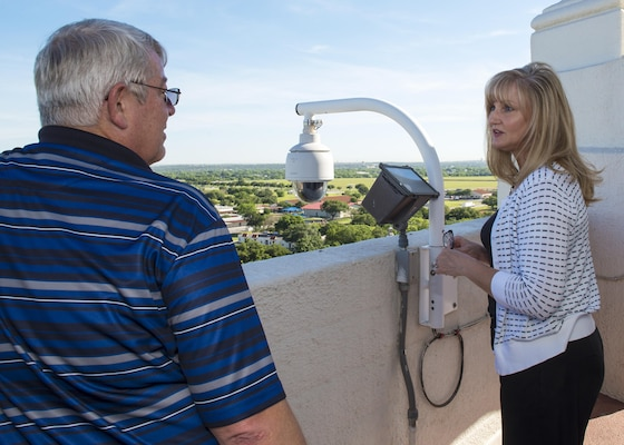 Tracey Powell, 502nd Security Forces Logistics Support Group deputy director of the commander's action and Taj facility manager, accompanies Bryan Hinton, 502nd Civil Engineering Squadron technician and planner, to the top of the Taj to inspect outdoor lights May 5, 2016. The beacon at the top of the Taj can be seen for 50 miles by pilots and identifies Joint Base San Antonio-Randolph as a military base.