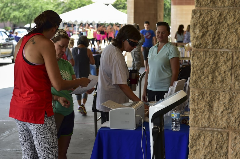 Health and Wellness Center representatives' discuss healthy lifestyle choices with shoppers at the 2nd Annual Healthy Lifestyle Festival at Hurlburt Field, Fla., July 8, 2016. The festival was an opportunity for Airmen and their families to be educated on the importance of healthy lifestyle choices. (U.S. Air Force photo by Senior Airman Jeff Parkinson)