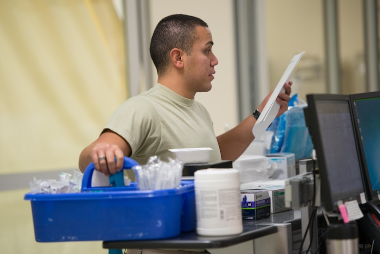 Airman 1st Class Daniel Anchondo, 81st Medical Operations Squadron lab technician, prepares to draw bloodwork from a patient in the emergency services department at the Keesler Medical Center July 1, 2016, on Keesler Air Force Base, Miss. Keesler's emergency room, which is open 24/7, sees around 2,000 patients monthly and is one of several clinics in the medical center. (U.S. Air Force photo by Marie Floyd/Released)