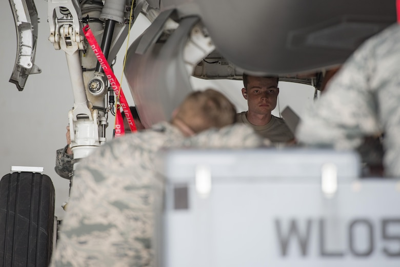 Airman Dylan Snead, 33rd Aircraft Maintenance Squadron load crew member, loads a GBU-12 into an F-35 during a weapons load crew competition July 8, 2016, at Eglin Air Force Base, Fla. The ability to quickly and safely load an aircraft with munitions is integral to provide combat-ready jets to combatant commanders. (U.S. Air Force photo by Senior Airman Stormy Archer/Released)