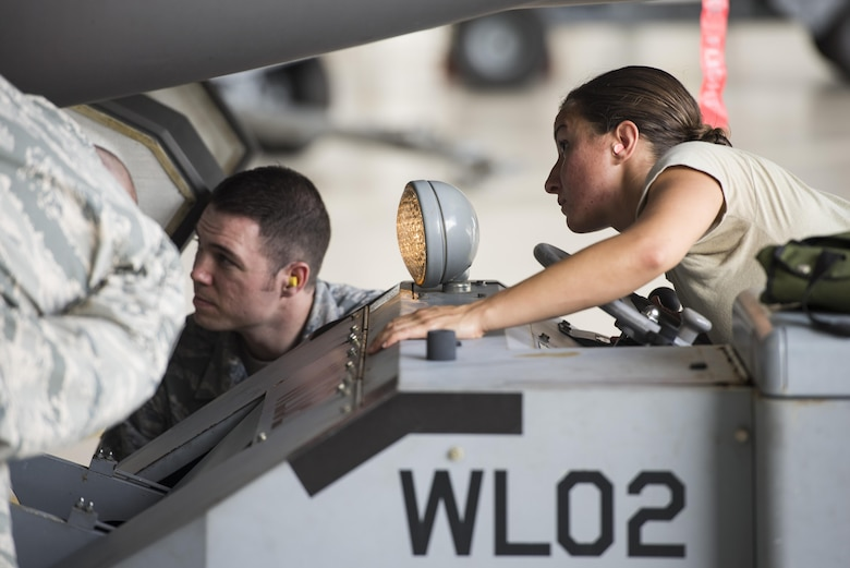 Senior Airman Danielle Gschwendner, 33rd Aircraft Maintenance Squadron load crew member, drives a jammer during a weapons load crew competition July 8, 2016, at Eglin Air Force Base, Fla. The load crew competition showcased the efficiency of load crew teams to safely and properly arm an F-35 within time constraints. (U.S. Air Force photo by Senior Airman Stormy Archer/Released)