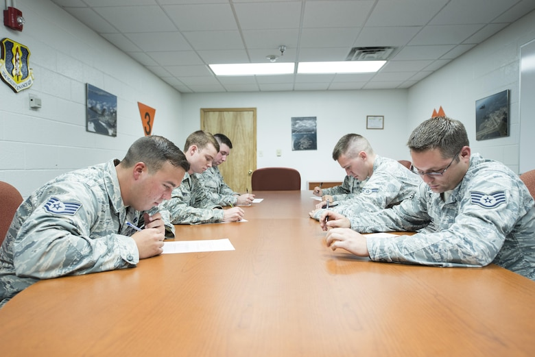 Members of the 33rd Aircraft Maintenance Squadron take a written exam during a weapons load crew competition July 8, 2016, at Eglin Air Force Base, Fla. The written exam tests the Airmen's knowledge on weapons loading operations and safety standards. (U.S. Air Force photo by Senior Airman Stormy Archer/Released)