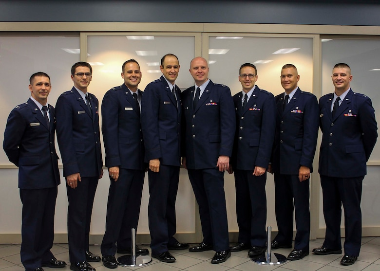Airmen from Nellis Air Force Base, Nev., pose for a photo after graduating from the Family Medicine Residency Program at Mike O'Callaghan Federal Medical Center June 30. The primary goal of the program is to produce highly qualified, board-eligible family physicians capable of providing continuing and comprehensive care to the individual and family as an integrated unit, in any military or civilian medical system.