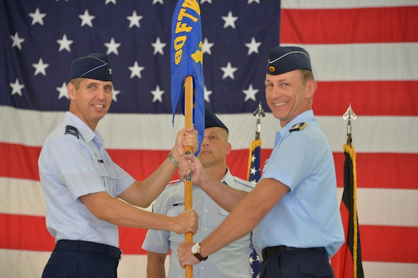 80th Flying Training Wing commander, Col. Gregory Keeton, officiates the 80th Operations Group change of command ceremony at Sheppard Air Force Base, Texas, July 6, 2016. Italian Air Force Col. Paolo Baldoasso, 80th Operations Group commander, relingquished his command to German Air Force Col. Bernhard Hey. (U.S. Air Force photo/ Elizabeth Colunga)
