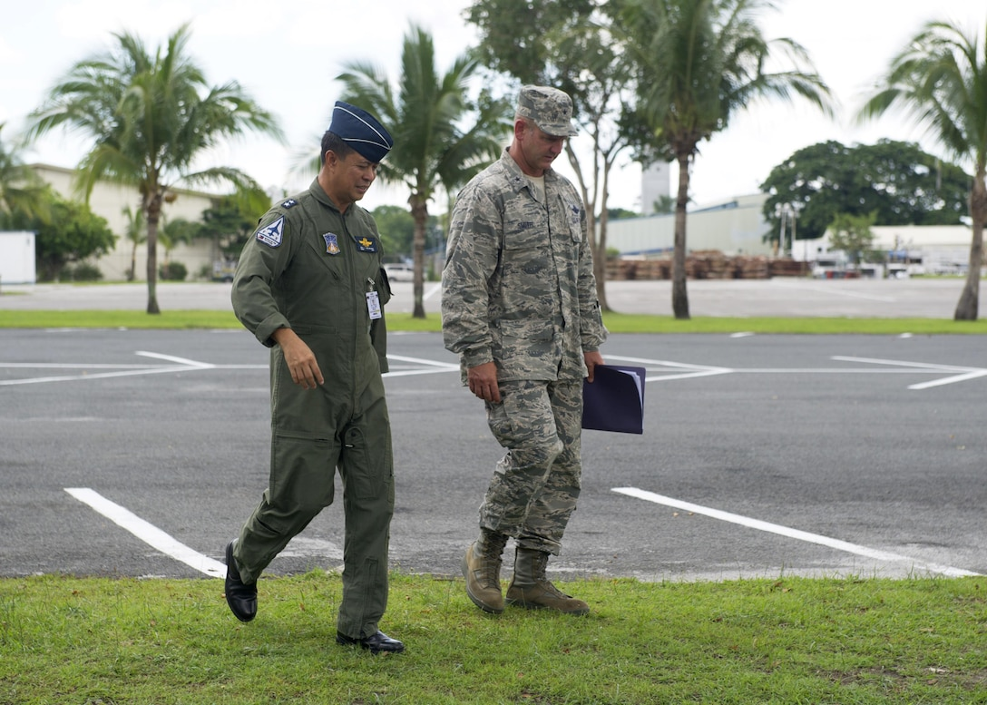 U.S. Air Force Brig. Gen. Dirk Smith, the Pacific Air Forces Director of Air and Cyberspace Operations, and Philippine Air Force Maj. Gen. Raul del Rosario, the PAF First Air Division commander, walk and discuss daily operations during a site visit to Clark Air Base, Philippines, June 29, 2016. The Electronic Attack Squadron (VAQ) 138 expeditionary detachment was at Clark to excercise bilaterally with Armed Forces of the Philippines members and provide support for routine operational missions that enhance regional maritime domain awareness. (U.S. Air Force photo by Staff Sgt. Alexander Martinez/Released)