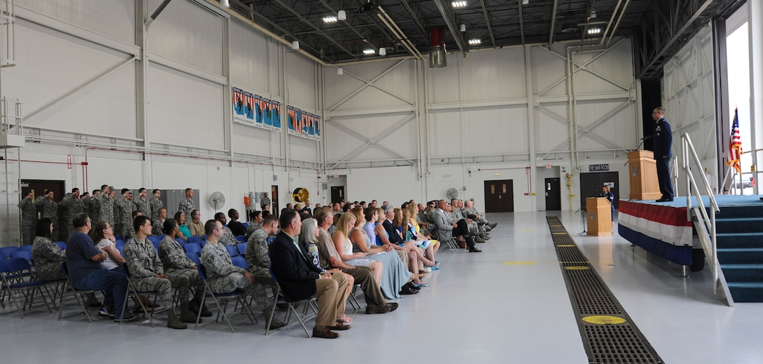 U.S. Air Force Maj. Nathaniel Osborne, the commander of the 509th Communications Squadron (CS), receives the formation first salute during the 509th CS change of command ceremony at Whiteman Air Force Base, Mo., July 6, 2016. Osborne assumed command from U.S. Air Force Lt. Col. Eric Tucker. (U.S. Air Force photo by Senior Airman Danielle Quilla)