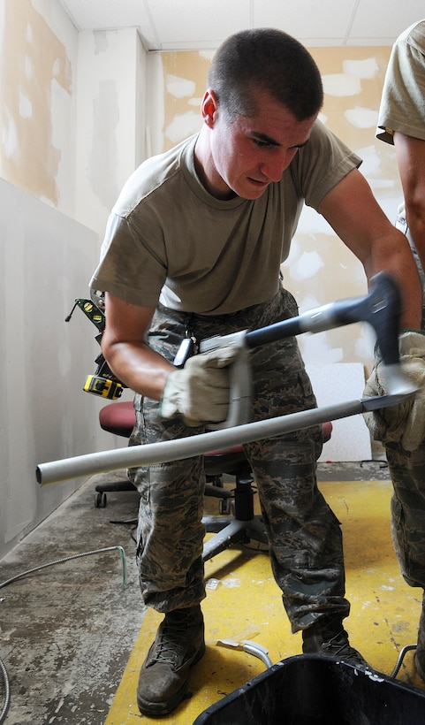 U.S. Air Force Senior Airman Eric Miller, a 509th Civil Engineer Squadron electrical systems journeyman, saws a conduit for new wiring at Whiteman Air Force Base, Mo., July 5, 2016. Metal conduits are a wiring method that provides mechanical protection to the enclosed electrical system. (U.S. Air Force photo by Airman 1st Class Michaela R. Slanchik)