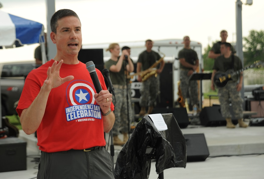 U.S. Air Force Brig. Gen. Paul W. Tibbets IV, the 509th Bomb Wing commander, gives opening remarks during the Independence Day Celebration at Whiteman Air Force Base, Mo., June 30, 2016. A performance by the Missouri National Guard's 135th Army Band followed the opening remarks. (U.S. Air Force photo by Senior Airman Danielle Quilla)