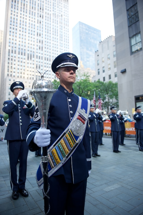 The Ceremonial Brass, led by Drum Major Senior Master Sergeant Daniel Valadie, performed live on Rockefeller Plaza for NBC's The TODAY Show in New York City.  The July 4th performance featured Master Sergeant Tara Islas' arrangement of Strike Up The Band. (USAF Photo by Chief Master Sgt Bob Kamholz/released)