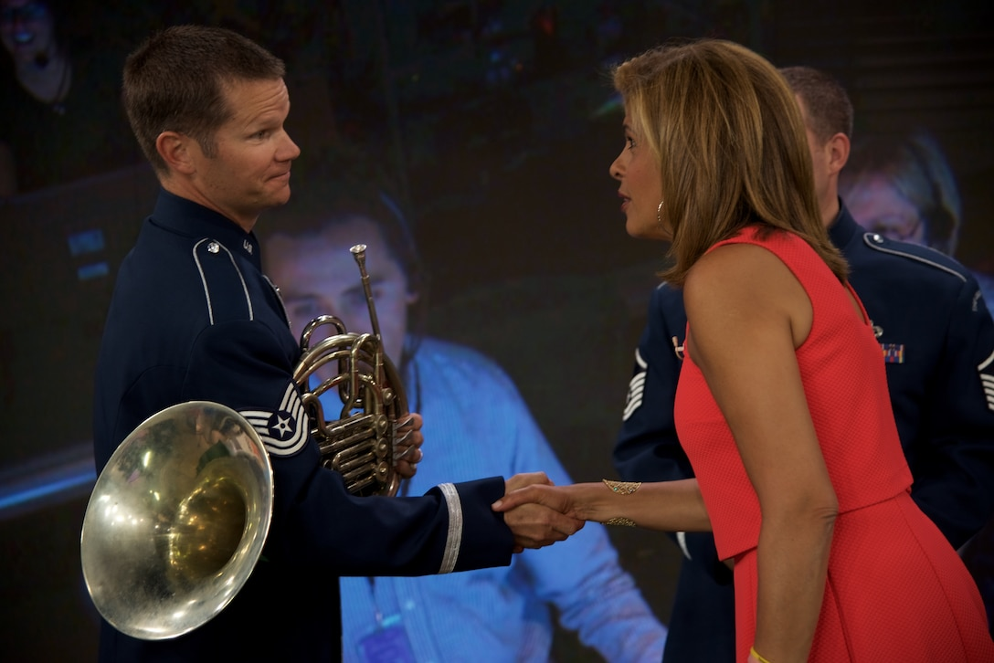 Technical Sergeant Joel Wealer shakes hands with Hoda Kotb after a special 4th of July performance by members of the Ceremonial Brass Quintet on Kathie Lee and Hoda on NBC's The TODAY Show. (USAF Photo by Chief Master Sgt Bob Kamholz/released)