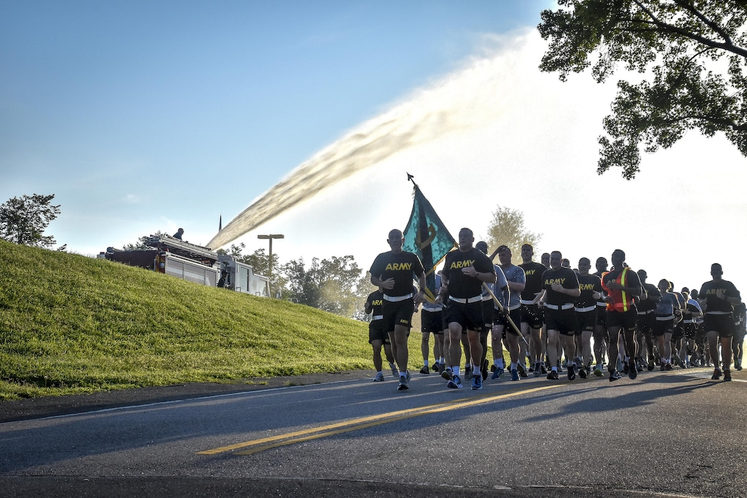 """LTG Charles D. Luckey, Chief of Army Reserve and U.S. Army Reserve Commanding General, and Brig. Gen. Robert D. Harter, director of Office of the Chief, Army Reserve, led Soldiers assigned to the Office of the Chief, Army Reserve, on a morning run at Fort Belvoir, Virginia, July 8, 2016.  As the Chief of Army Reserve and Commanding General, Luckey leads a community-based force of more than 200,000 Soldiers and Civilians with a """"footprint"""" that includes 50 states, five territories, and more than 30 countries.  (U.S. Army photo by Master Sgt. Marisol Walker)"""
