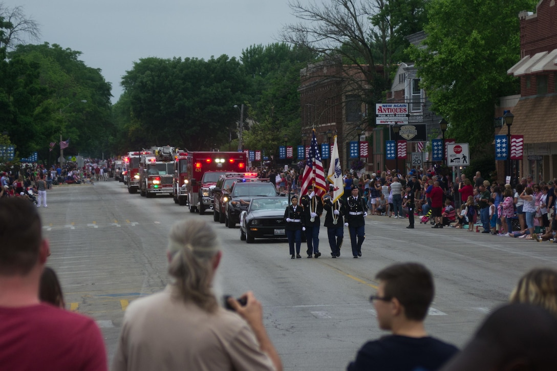 From left, Spc. Abigail Billups, Staff Sgt. Luis Lopez, Sgt. Stephen Galvin, and Staff Sgt. Adam Tracy, all assigned to the 416th Theater Engineer Command, march through Brookfield, Illinois, as members of the color guard, during the Independence Day parade, Jul. 4, 2016. (U.S. Army photo by Staff Sgt. Jason Proseus/Released)