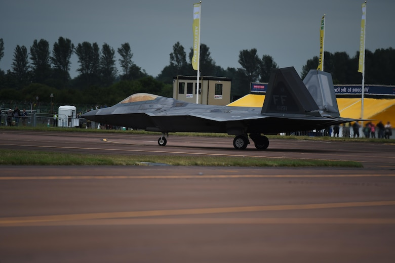 A F-22 Raptor, with the Raptor Demonstration Team, taxis past onlookers prior to its performance at the Royal International Air Tattoo, hosted on RAF Fairford, July 8-10, 2016. RIAT 16 afforded an opportunity for new aircraft, like the F-35 Lightning II, to be displayed alongside crowd favorites and provided a weekend of fun and entertainment for the projected 160,000 visitors. (U.S. Air Force photo by Airman 1st Class Zachary Bumpus/Released)