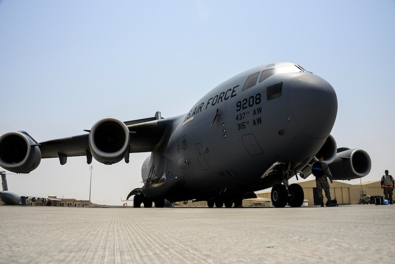 A C-17 Globemaster III sits on the flight line while Airmen from the 8th Expeditionary Air Mobility Squadron, Aircraft Maintenance Flight finish their preflight inspection June 30, 2016, at Al Udeid Air Base, Qatar. The 8 EAMS provides airlift capability to units across the U.S. Air Forces Central Command area of responsibility in support of Operation Inherent Resolve, Freedom Sentinel and Combined Joint Task Force - Horn of Africa. (U.S. Air Force photo/Senior Airman Janelle Patiño/Released)