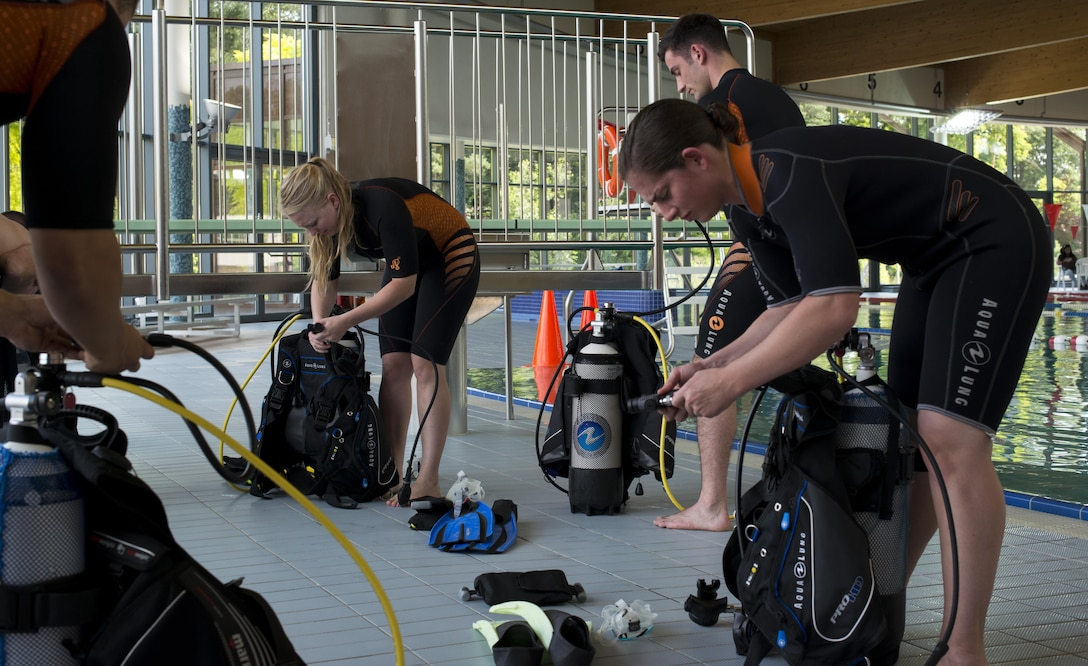 Students of the Ramstein Aquatic Center's Professional Association of Diving Instructors Open Water Certification class prep their gear July 6, 2016, at Ramstein Air Base, Germany. The course includes four days of classroom and hands-on application in a pool and two days in open water at a lake. (U.S. Air Force photo/Airman 1st Class Tryphena Mayhugh)