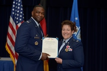 U.S. Air Force Col. Alfred Flowers, 52nd Medical Group commander, left, presents the Meritorious Service Medal to U.S. Air Force Col. Ann Blake, outgoing 52nd Dental Squadron commander, during the 52nd DS change of command ceremony on Spangdahlem Air Base, Germany, July 11, 2016. Blake received the MSM in recognition of her service of leading the 52nd DS. (U.S. Air Force photo by Staff Sgt. Jonathan Snyder/Released)