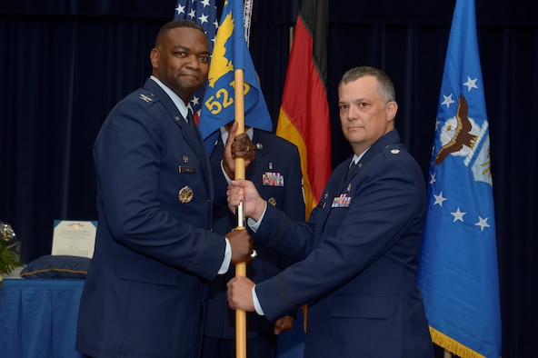 U.S. Air Force Col. Alfred Flowers, 52nd Medical Group commander, left, gives the ceremonial guidon to U.S. Air Force Lt. Col. David Jones, incoming 52nd Dental Squadron