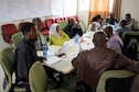 Ethiopian Public Health Institute members participate in a class conducted by the Center for Disease Control and Prevention, which taught the basics for structuring developmental action plans in the case of a disease outbreak in Ethiopia, February 2016. (Courtesy Photo)