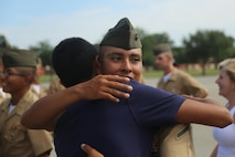 U.S. Marine Corps Pfc. Johnny Mendez with Lima Company, Recruit Training Regiment, Marine Corps Marine Recruit Depot Parris Island (MCRD PI), hugs Edwin Mendez, his brother, after a U.S. Marine Corps basic training graduation ceremony at Peatross Parade Deck, MCRD PI, S.C., July 8, 2016. Mendez graduated after 3 months of Marine Corps basic training. (U.S. Marine Corps photo by Lance Cpl. Colby Cooper/released)