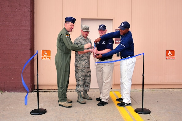 U.S. Air Force Col. Marty Reynolds, commander of the 55th Wing, joins Offutt Field House staff members in cutting the ribbon to the new after-hours facility at Offutt Air Force Base, Neb., July 7, 2016.  The 1,000 square foot corner of the Department of Defense's largest fitness facility will provide access to fitness equipment for swing shift members of Team Offutt.  (U.S. Air Force photo by D.P. Heard/Released)
