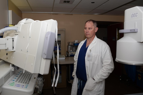 Dr. (Retired U.S. Army Lt. Col.) Ronald White, 60th Medical Surgical Operations Squadron chief of anesthesia and pain medicine, reviews X-rays in the David Grant USAF Medical Center at Travis Air Force Base, Calif., July 1, 2016. White oversees operations of the DGMC's Pain Clinic which opened in April 2016. The clinic provides services for patients experiencing acute pain, as well as chronic pain. Photo altered for security purposes. (U.S. Air Force photo by Tech. Sgt. James Hodgman/Released)