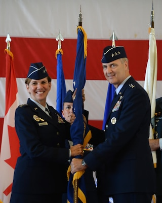 Gen. Lori Robinson, commander of North American Aerospace Defense Command and United States Northern Command, passes the guidon to Lt. Gen. Scott Williams, the incoming commander of Continental U.S. NORAD Region-1st Air Force (Air Forces Northern), at the CONR-1st AF change of command ceremony at Tyndall AFB, Fla., July 6, 2016. First Air Force has the responsibility of ensuring the air sovereignty and air defense of the continental United States. (U.S. Air Force photo by Airman 1st Class Cody R. Miller/Released)