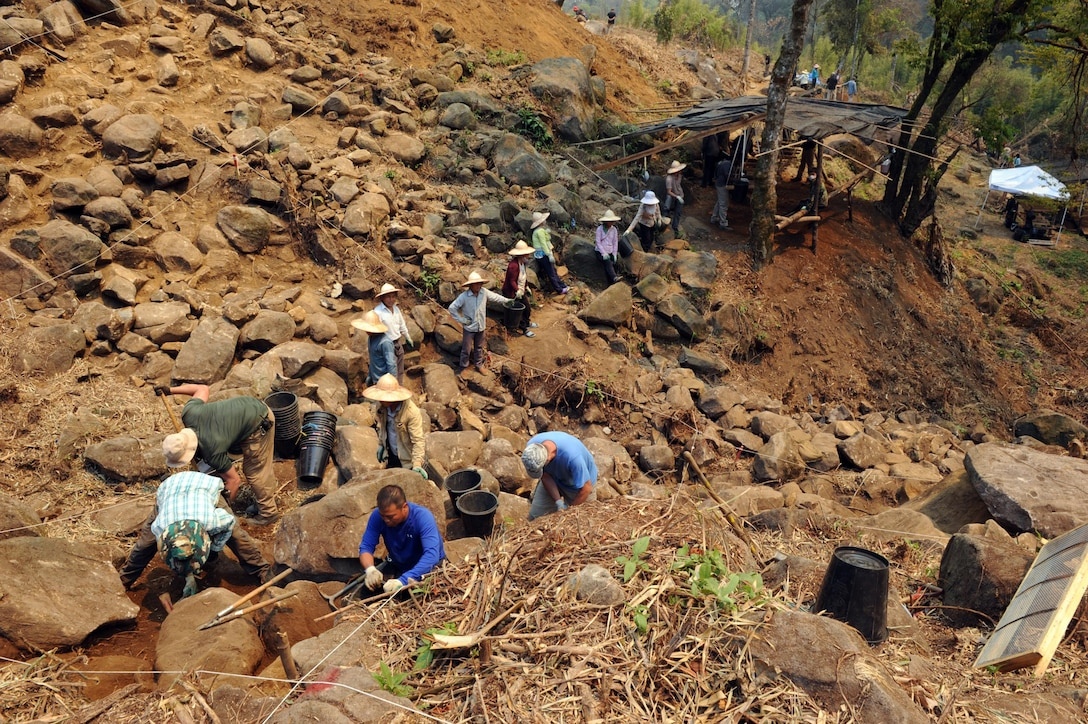 Members of the Defense POW/MIA Accounting Agency (DPAA) work with local villagers during excavation in the Xiangkhoang Province, Lao People's Democratic Republic, Mar. 18, 2016. Members of the DPAA deployed to the area in hopes of recovering the remains of a pilot unaccounted for during the Vietnam War era. The mission of the DPAA is to provide the fullest possible accounting for our missing personnel to their families and the nation. (DoD photo by Staff Sgt. Jocelyn Ford, USAF/RELEASED)