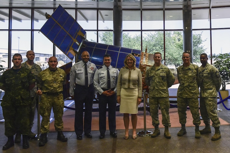 Air Force Secretary Deborah Lee James poses with 460th Space Wing leadership and foreign mission before receiving a briefing about the capabilities and missions performed by the base July 7, 2016, at Buckley Air Force Base, Colo. During her time here, James viewed the 460th Space Wing's Mission Control Station and spoke with space operators in their work centers and on the operations floor. (U.S. Air Force photo by Tech. Sgt. Nicholas Rau)